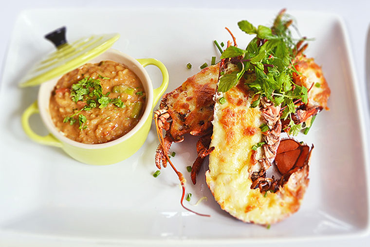 Roasted lobsters in garlic and butter with risotto