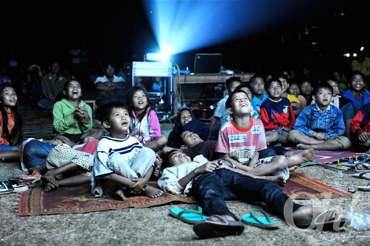 Kids enjoying a shadow theater, one form of entertainment in some provinces of Laos.