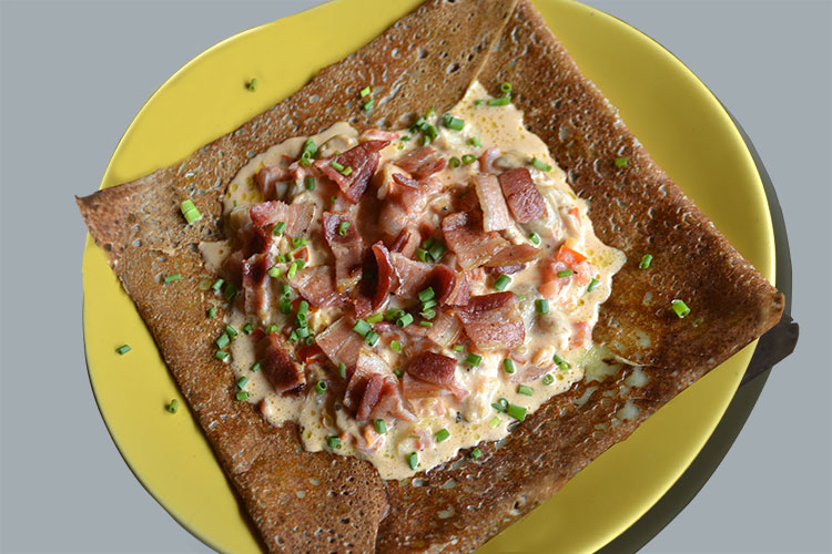 Crepe campagnarde- buckwheat crepe topped with cheese, cream, bacon, tomato, and mushroom.